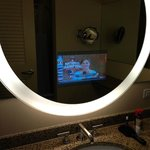 TV in mirror in bathroom