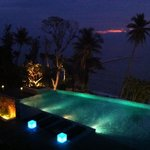 Night-time view of the pool