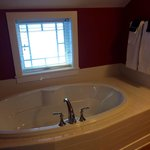 Sweet William. There is a soaking tub and stand alone shower. Beautifully renovated bathroom wit