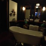 gigantic bathroom with old school british bath tub