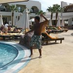 Hima at the pool doing the hotel dance