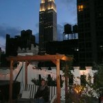 Our daughter sat on the rooftop terrace (Empire State in the background)