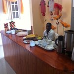 Breakfast is at the reception, standing up. Self service. Weak coffee. Old bread. Bananas. ... s
