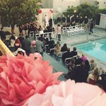 Ceremony around the pool.