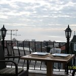 View from the terrace- note lovely outiside table setting, balcony rails. Bosphorus view on one