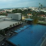 View of the swimming pool from our room with central Melaka in the background