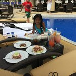 My lil Neice enjoying some poolside food!