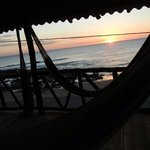 sunset from a hammock on the deck! great end to a long day of surfing.