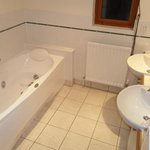 2 bathroom both with spa bath a walk in showers