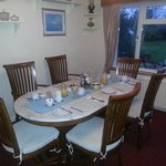 the breakfast room with garden view at Rowen