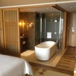 Bathtub in center of room.