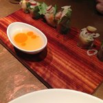 frozen grape on top of sushi with chili oil dipping sauce