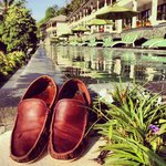 My weathered shoes at the end of Lombok's longest infinity pool