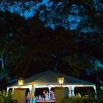 Our wedding under a white tent beside the pool area