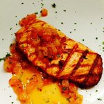Grilled Atlantic Salmon, with a spicy, local ruby red grapefruit relish.