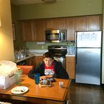 Cute little kitchen with even cuter teen at the table