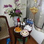 In room, welcoming bottles of water, tea coffee and fruit basket.