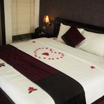 Honeymoon decorated room with fresh rose petals