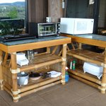 Suite outdoor cooking area with cleaning solution/rags to clean off creature droppings on tables