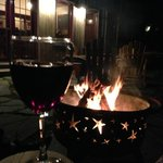 Enjoying wine by the fire!