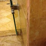 Grime and cracking plaster on shower rrom