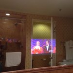 TV in the bathroom mirror.