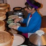 Lady making banh cuon