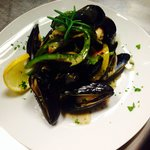 P.E.I. Mussels steamed with tri-color bell peppers, finished w