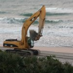 Heavy equipment moving up/down beach