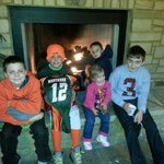 My kids gathered around the fire place