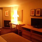 Flat panel t.v, fireplace, microwave, coffee maker too in a nicely up to date furnished room.