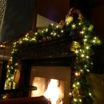 Festive decorations around warm fire
