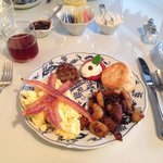 Amazing main course: eggs, bacon, sausage, hash browns, biscuit!