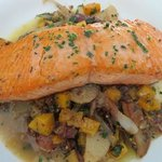 Salmon over winter vegetable hash