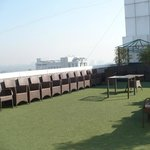 terace with artificial lawn and seats