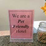 The sign on the front desk says it all - dog treats on the counter