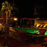 Night shot of pool & lounge area