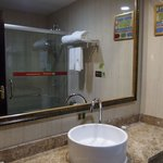 Spacious bathroom with a separate shower stall.