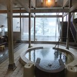 Indoor public Bath with full size window overlooking view outside