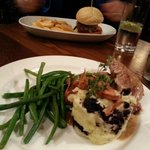 Pork tenderloin with black pudding mash & beans. Across the table the homemade burger & chips