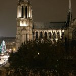 View of Notre Dame at night from the apartment window.