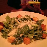 "$8 ""Caesar Salad"" lettuce with parm cheese and croutons. Awful."