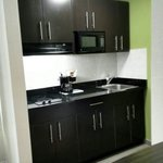 Fully equipped kitchens in very room.