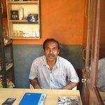 Mr. Kallam (shopkeeper) / at your service / regular prices
