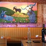 One of the colorful paintings at The Blue Goat