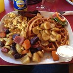Butterscotch peanut butter waffles with bananas foster, scrambled eggs with bacon, sausage and b