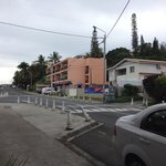Outside of the motel. Small shop is in the orange building.