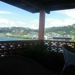 The lunch time veranda and out-side bar with views across the bay towards the town.