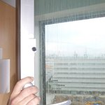 The window lock - just push the black button and pull the cord out to open the window