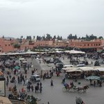 View of Djemaa el Fna as the food stalls start cooking for the evening.